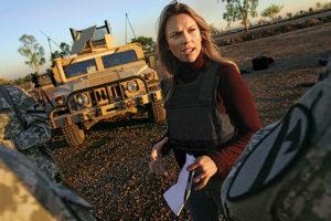 BAGHDAD, IRAQ - NOVEMBER 17: Journalist Lara Logan of CBS News questions U.S. Soldiers in Camp Victory in Baghdad, Iraq November 17, 2006. (Photo by Chris Hondros/Getty Images)